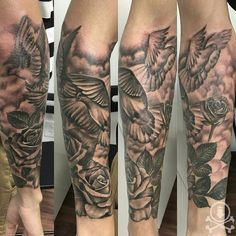 Lovely black and grey 3/4 sleeve tattoo featuring doves, roses, and clouds by Alex Feliciano.  #12ozstudios #team12oz #tattoos #tattooartist #tattoosformen #tattoosforwomen #blackandgrey #animaltattoos #dove #roses