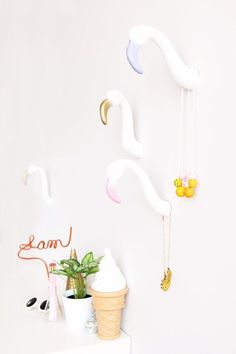 Add some flamingo head hooks to your wall.