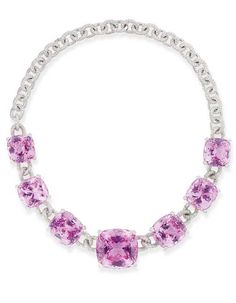 AN ATTRACTIVE KUNZITE AND DIAMOND NECKLACE, BY MICHELE DELLA VALLE   Composed of seven graduated cushion-shaped kunzites within diamond-set mounts and claws to the pavé-set diamond ropework neckchain, 42.4 cm. long, in Michele della Valle black pouch  With maker's mark for Michele della Valle, No. 10574