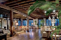 """The dining and living areas. """"We re-created things that came into Gerry's life—from his travels in Europe or even from an old coffee shop in New York,"""" Restaino says."""
