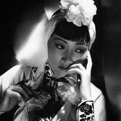 "Anna May Wong, 1905 - 1961 In the late 1930's Anna made several small budget films for Paramount Studios. They were often dismissed by critics but higher profile films were subject to harsher censorship and these low budget productions provided a platform for Anna to portray non-stereotypical Chinese characters. In 1937 she starred in ""Daughter of Shanghai"" which was rewritten with her as the heroine of the story. In 1939 she played the part of a doctor in the film ""King of Chinatown""…"