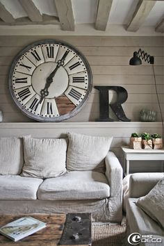 Again with the big clock that my mom loves! This room truly feels like it is one that could be sat in and played in for grandchildren! I love the accessories and coffee table. I know if my mom asks nicely enough, my dad will totally make her one like it ;)
