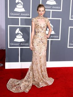 2012 Grammy Awards. Taylor Swift slicked her hair back into a chic bun, which was the perfect understated 'do to let her show-stopping Zuhair Murad mermaid gown do all the talking. To add to the gold rush, the Grammy-nominated singer accessorized with Neil Lane earrings.