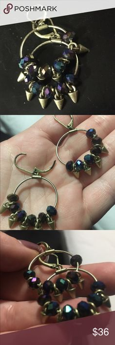 😎 Unique rocker chic hoops These are one of my faves! These hoops clamp shut so you don't lose them, they are gold (not real) with dark purple and dark blue spikes (not sharp) that dangle. Easy to put on, easy to take off. Will only sell for the *right* price. Open to acceptable offers. Jewelry Earrings