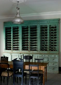 Table, mixed black chairs, gorgeous cabinet/wine storage - colour.