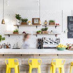 This photo is all about the wooden bench and the use of the yellow stools... Don't forget the use of greenery