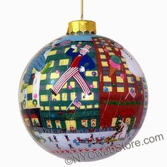 NYC Christmas Parade Glass Ball Ornament featuring the Christmas parade. (http://www.nycwebstore.com/nyc-holiday-parade-glass-ball-ornament/)