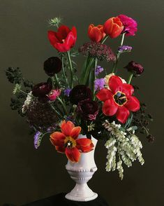 A bright and abstract urn arrangement with Spring time blooms of Tulips, Ranunculus, Queen Anne's Lace, Boronia, Andromeda and Statice. Queen Annes Lace, Ranunculus, Urn, Spring Time, Tulips, Wedding Flowers, Bloom, Bright, Abstract