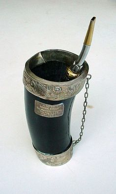 """This is a """"Guampa"""" that contains the Yerba Mate. Iced cold water mixed with medicinal herbs are poured on it; also used as an alternative medicine in Paraguay. This Guampa is made from cow horns and handcrafted silver. Love Mate, Yerba Mate Tea, Different Types Of Tea, Popular Drinks, How To Order Coffee, Cow Horns, Coffee And End Tables, Medicinal Herbs, Tea Time"""