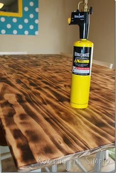 DIY Dining Table with Burned Wood Finish using a BernzOmatic Blow Torch Want a dining table with an unique finish rather than just putting stain on it? Burn the wood and you will have an elegant and gorgeous dining table! Easy Woodworking Projects, Diy Wood Projects, Wood Crafts, Woodworking Finishes, Woodworking Books, Woodworking Workbench, Woodworking Videos, Woodworking Furniture, Wood Pallet Flooring