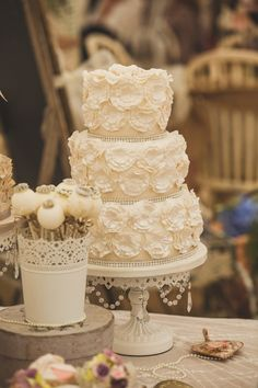 Vintage cream ruffled wedding cake.