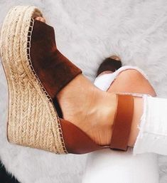 Brown espadrille wedges.