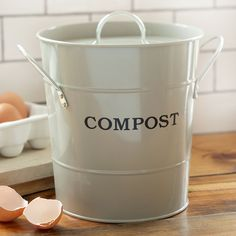 Save yourself multiple trips to the compost bin with one of these lovely compost caddies in the kitchen. How cute!