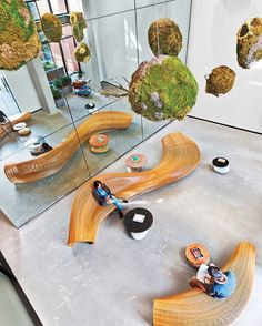 Reception at Dropbox's San Francisco outpost by @RaptStudio features a constellation of moss-wrapped spherical sculptures that hangs over serpentine benches in steam-bent oak strips, all set atop polished concrete flooring. : Eric Laignel. @sandow... - Interior Design Ideas, Interior Decor and Designs, Home Design Inspiration, Room Design Ideas, Interior Decorating, Furniture And Accessories
