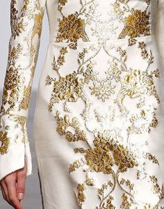 Gorgeous...Love the color, fabric, & silhouette. Cheaper to have custom-made than purchasing from salon. Ask your seamstress for fabric suggestions that fit your budget.