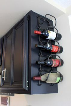 wine rack mounted on the end of the cabinet