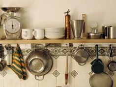 13 Best DIY Budget Kitchen Projects: Incorporate storage onto your backsplash and walls. Besides pre-made shelves, many retailers sell hooks, racks and rails that will hold all sorts of kitchen gadgets.    From DIYnetwork.com