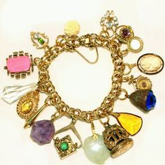 "Antique Chunky Charms on Gold Filled Bracelet, Cameo, Real Amethyst, Carved Jade.  I have a number of upcycled vintage and antique charm bracelets, including this antique charms bracelet available only at the ""Vintage Jewelry Stars"" shop at http://www.rubylane.com/shop/vintagejewelrystars!!"