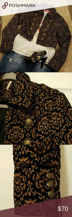 "Free People jacket NWOT, authentic brand,  bought it and it wasn't never worn. Brand new looking, but no tags. Cropped bolero design with buttons at the sleeves, shoulders and chest. Nice weight to it. Fully lined. Lenght 16.5"" approx, bust 17.5"" approx. It can be worn open or close, it has hooks to get it to close. Fabric blend of cotton and polyester Free People Tops"