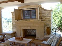 Outdoor Tv, locked away WITHIN the stone fireplace surround, love it. remember to RUN CONDUIT through brick when building