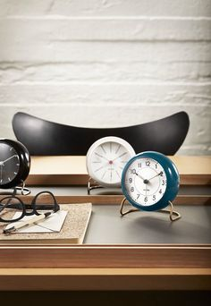 "Arne Jacobsen's ""LK table clocks"" from 1941. The table clock is available with different dial design, but still in the original case and with the metal base, as the clock is created with."