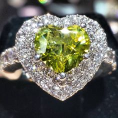 www.ItsHot.com Green heart-shaped diamond surrounded by clusters of white diamonds, also in a heart shape. Classic Wedding Rings, Heart Shaped Diamond, Jewelry Boards, White Diamonds, Diamond Are A Girls Best Friend, Cupid, Peridot, Birthstones, Heart Shapes