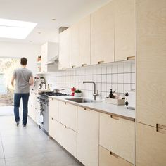 Ikea kitchen cabinets with bespoke birch plywood doors and drawer fronts