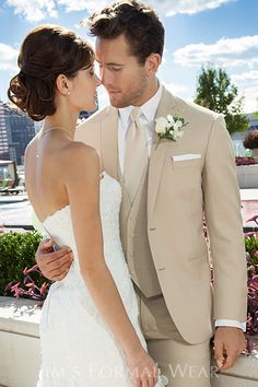 tan suit with vest This is cute...or even just the groom in the tan and the groomsmen with a chocolate color suit