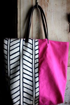 cute idea to do two different fabrics - plus love the leather straps.