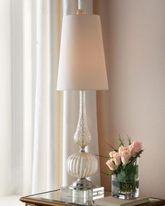 """Clear Venetian-Style Glass Lamp A tall, slender lamp with a fluted glass base and creamy shade gives off a gentle glow wherever you need a little light. Made of hand-blown glass with a creamy linen shade. Uses one 150-watt bulb; three-way switch. 10""""Dia. x 34.75""""T. Imported."""