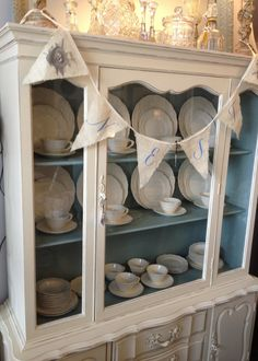 China Cabinet painted with Chalk Paint® deocrative paint by Annie Sloan Old White outside and Duck Egg inside.