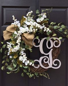 This gorgeous grapevine wreath is sure to be the rustic chic touch your home needs! Wreath measures approximately 19-20 in diameter when finished and is adorned with beautiful white blossoms, greenery accents, burlap bow, and optional 12 vine font monogram. Monogram comes in a variety of color options:  -Taupe (pictured) -Red -Cream -White -Distressed White  Please make sure to include your choice of letter for the monogram in the NOTE TO SELLER section at checkout.  **Check out our other…