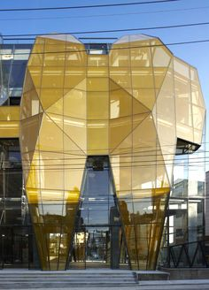 "The Yellow Diamond, Seoul, South Korea. ""I felt that uninhibited artistic expression was appropriate for the site,"" says architect Jun Mitsui of the Yellow Diamond building, located in one of the most creative districts of Seoul. It is envisioned as a center where emerging artists can promote their work. A combination of right color and rhythm will give the building the impact to support its proposed use. The exterior is angled planes of gold-yellow frit-pattern glass representing a unique…"