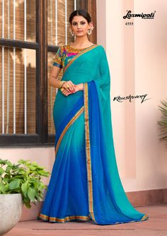 Mesmerizing Blue Colored Stone & Pogo Work with Satin Printed Lace Border along with Multicolor Fancy Blouse by Catalogue-KHUSHRANG Price Design Laxmipati Sarees, Georgette Sarees, Silk Sarees, Saris, Lehenga, Indian Dresses, Indian Outfits, Indian Clothes, Online Shopping Sarees