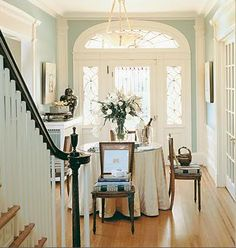 Gorgeous gorgeous entryway and use of intricate window detail and natural light (Dan Proctor of Kirk Designs)