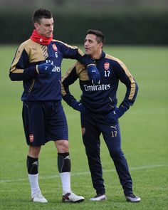 Laurent Koscielny and Alexis Sanchez take a break during training. (January 21, 2016)