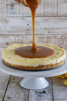 Creamy white chocolate cheesecake has macadamia nuts throughout, with a homemade caramel sauce poured over the top. White Chocolate Cheesecake, White Chocolate Chips, Delicious Desserts, Yummy Food, Homemade Caramel Sauce, Food Inspiration, Sweet Recipes, Sweet Tooth, Sweet Treats