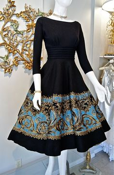 Love the elegance of the 3/4 length sleeves, boatneck, and full, pattern-border skirt. Divine!