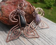 ...so since summer is here (at least on a calendar) and summer markets are here, I was thinking about some designs that represent summer and the ocean...and made 2 whale tail pendants..made out of copper wire and beach rocks.. www.facebook.com/petra.leblanc