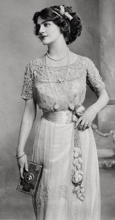 Edwardian fashion- I didn't know where to pin this.  But, isn't she lovely!  The dress is gorgeous.  The hair is to die for.  The purse is the perfect accessory.