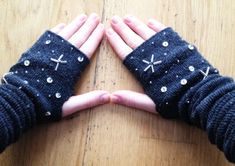 Sock fingerless mitts from Shelterness.  Cute embellishments for any gloves.