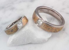 This beautiful engagement set features matching Mokume Wave Engagement Rings. Pictured in our Trigold Mokume Gane.