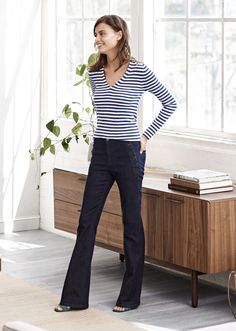 Add a Parisian flair to your look by pairing our sailor flare jeans with a classic striped long sleeve tee | Banana Republic