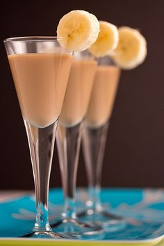 Whoville Banana Shot (6): Combine 3oz Godiva dark chocolate liqueur, 2oz rum cream liqueur(e.g. Rum Chata or Sangsters) (OR use Amarula cream liqueur), 1.5oz banana liqueur, 1oz spiced rum. Pour into shot glasses; garnish with banana slice. -- [OO]