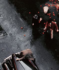 betterfailures:    Gordon Willis insisted that every shot represent a point of view, usually setting his camera about four feet off the ground, keeping the angle flat and even. Francis Ford Coppola managed to get him to do one aerial shot in the scene when Don Vito Corleone is gunned down, telling Willis that the overhead shot represented God's point of view.