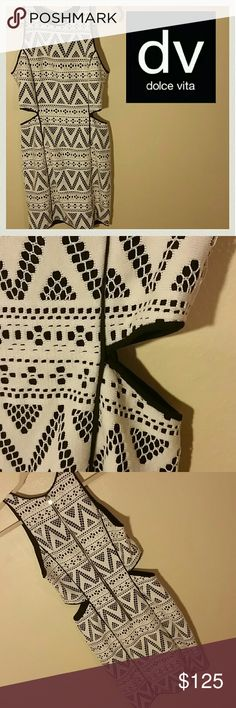 """SALE! NWOT! DOLCE VITAAztec Dress -S NEVER WORN. EVER. Flawless condition. The lining is Smoothe black fabric. There is a hole at the waist of each side. Soft diamond shape.  It will expose a little skin. It's subtle and sexy. There's an aztec eyelet print in the white material exposing the black underneath. It is a body con. High scoop neck. Long zipper down the back. Mini dress. Super comfy materials. No stains, rips, or tears. Perfect. Outer 100% Poly lining 97% Poly 3% Spandex 34 1/2""""…"""