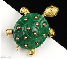 "Description: Vintage signed Trifari figural turtle brooch, gold tone metal, green lucite. Designer/Makers Marks, Hallmarks, Tags: Crown Trifari. Age: Circa 1960's. Dimensions: 1.8""x1.3"". Condition: Ex"