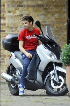Liam riding a motor cycle. Soo attractive.