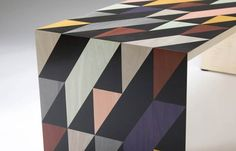 The #colours of this hand cut #marquetry were selected for impact, but will co-ordinate in many interior #schemes. Part of a range of #furniture. http://www.makerseye.co.uk/designers/w/toby-winteringham/shift-low-table,-hand-cut-marquetry/ #MakersEye #bespoke #design #BritishCraftsmanship #interiors #lifestyle #BritishLuxury #decor