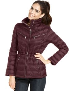 """Lightweight, yet totally warm, this MICHAEL Michael Kors puffer is the ultimate coat for chilly days out. The matching """"pack-sack"""" is perfect for an on-the-go lifestyle. - Nylon; lining: nylon; fill:"""